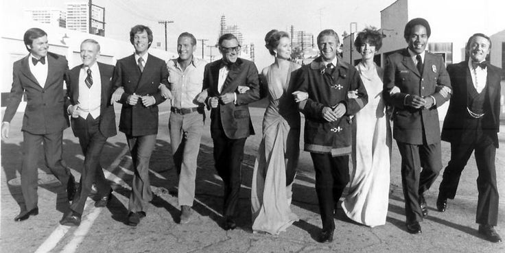 The cast for The Towering Inferno (1974) on the Fox lot in West Los Angeles - L-R Robert Wagner, Fred Astaire, Richard Chamberlain, Paul Newman, William Holden, Faye Dunaway, Steve McQueen, Jennifer Jones, OJ Simpson and Robert Vaughn