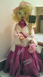 this doll is an altered  plastic bottle of cola ...real hands of an old doll and some fabrics....she asks for some money because she has to pay taxes...hahaha