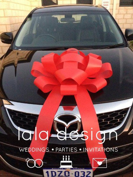 Car Bows! 80cm in lengh. We have Red/Gold and Silver available