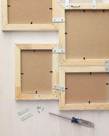 Turn basic photo frames into wall art by connecting frames with hardware called mending plates. Available at most hardware stores.