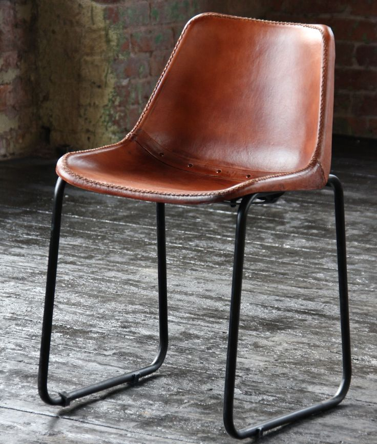 Leather Saddle Chair - The Saddle Chair represents a perfect balance of antique and modern. The expertly contoured seat is made from high-quality composite leather, featuring handsewn whipstitch and brass rivets, all of which evoke an aged, Western feel. Buy now from wheresaintsgo.co.uk/ for £119.00.