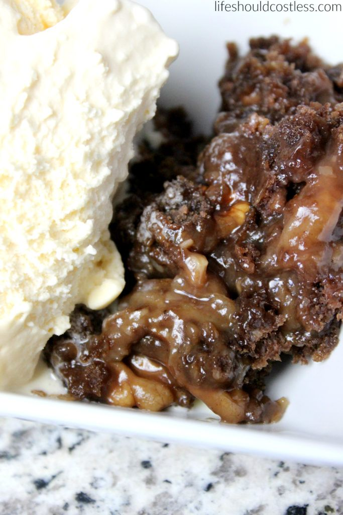 Slow Cooker German Chocolate Dump Cake. I love me an ooey gooey dump cake/cobbler as well as the next girl, They are so moist and are heavenly when topped with ice cream.  Rather than using a pie filling for the bottom, I used a can of the coconut pecan frosting and whole pecans and it turned out so yummy! My girls devoured this whole dessert in less than an hour if that tells you anything.
