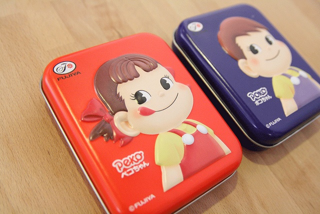 *new* Peko-chan tin candy cases by the little dröm store, via Flickr