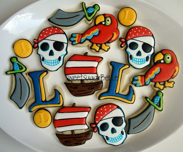 Scary pirate skulls, parrots, ships, swords and monogram cookies