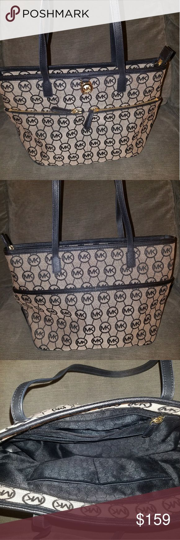 Michael Kors Black and Tan Tote Bag Authentic Michael Kors Black and Tan Tote Bag. Lightly used. Not noticeable Michael Kors Bags Totes