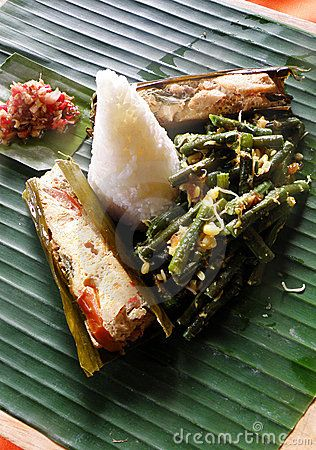 Ethnic asian food, fish dish with rice. Indonesia