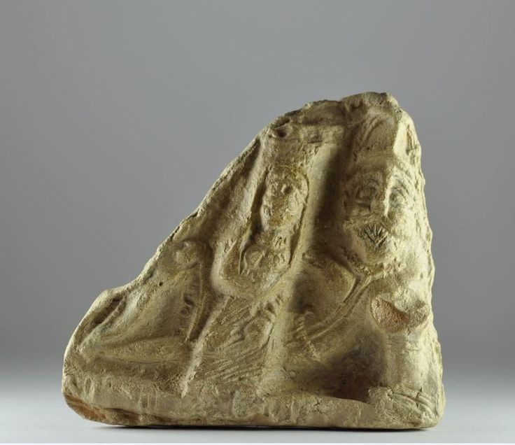 Parthian banqueters, 1st-3rd century A.D. Clay plaque with man and female, 16.6 cm long. Private collection