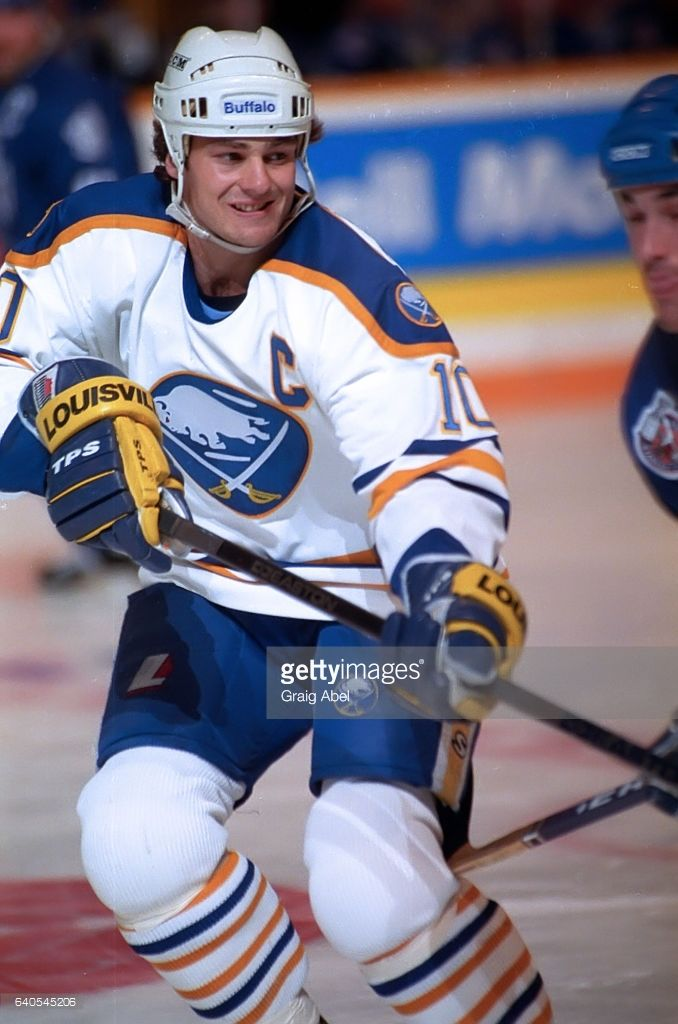 Dale Hawerchuk Of The Buffalo Sabres Skates Up Ice Against The