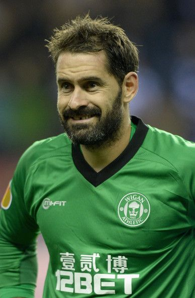 Scott Carson Photos Photos - Scott Carson of Wigan during the UEFA Europa League match between Wigan and NK Maribor at DW Stadium on October 3, 2013 in Wigan, England. - Wigan Athletic v NK Maribor