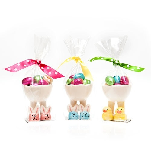 Egg cups wearing bunny slippers in pink and blue or a yellow duck.  Complete with coloured milk chocolate foil eggs inside the egg cups.  All packaged in a cello bag and coloured polka dot ribbon.  A fantastic, practical Easter gift for friends and family to enjoy!  £6.99 from the Fuschia Boutique at www.fuschiadesigns.co.uk.