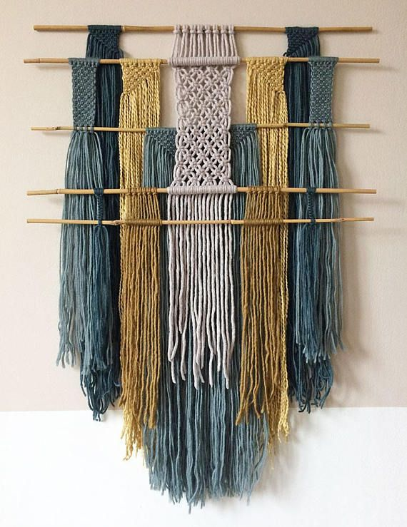 This colorful macrame wall hanging was handmade using bamboo sticks and layers of wool and cotton yarn. It adds color and texture to your interior and is made with natural materials. The bamboo dowels are 60-62cm wide and the wall hanging measures about 85cm from top to bottom. I chose not