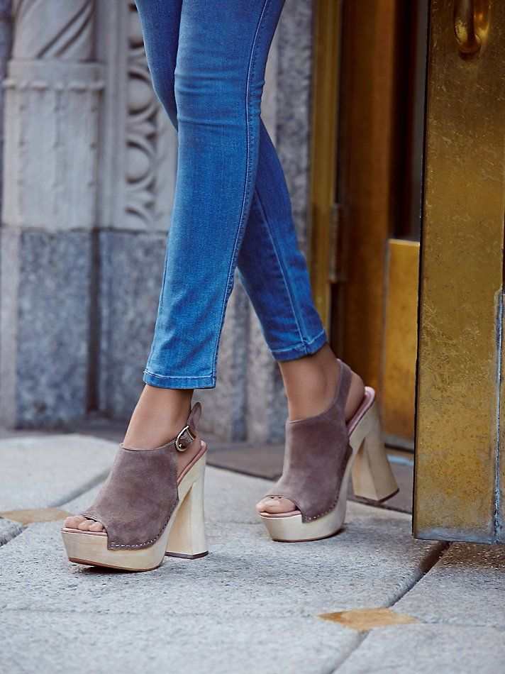 Sweet Jane Platform Clog   Made in collaboration with Jeffrey Campbell, these seventies inspired wooden platform clogs feature a suede body with an adjustable buckle strap in back.  Treaded rubber on the bottom of the heel.  Padded footbed for a more comfortable fit.
