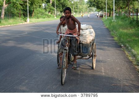A child pedalling a cart
