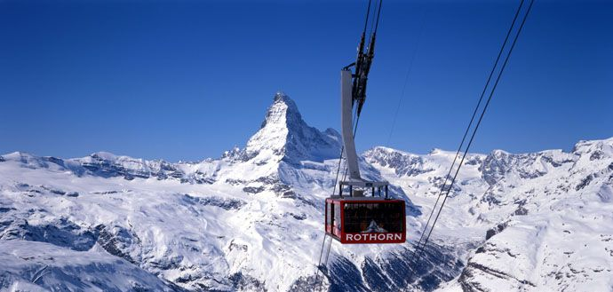 "Ski vacation package Zermatt - a car-free resort where the traffic consist of horse-drawn carriages. Dominated by the Matterhorn, the ""King of the mountains"" whose unique silhouette towers above the village. 38 fourthousand-metre peaks surround the village at the foot of the Matterhorn. You will ski down above 3800 m to the Italian village of Cervinia for lunch."