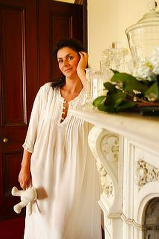 100% ivory silk luxury nightgown Alexandra with pintucks and exquisite hand embroidered roses down the front bodice  3/4 or cap (3 inch) sleeves, front opening with classic pearl shell buttons, length 120cms (46 inches) Alexandra is a classic style, elegant and supremely comfortable Sizes are small (10-12) medium (14) and large (16-18) Louise Mitchell uses only the best 100% silk and her silk nightwear can all be machine washed. Price is $239 We sell worldwide and shipping is free.