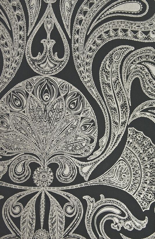 Malabar Wallpaper Black wallpaper with large metallic silver Paisley design in white.