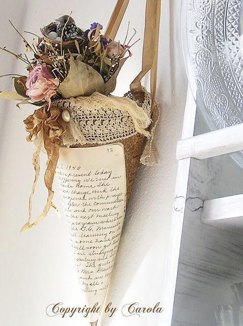 love this cone decorated with some dried flowers and a tiny spring nest