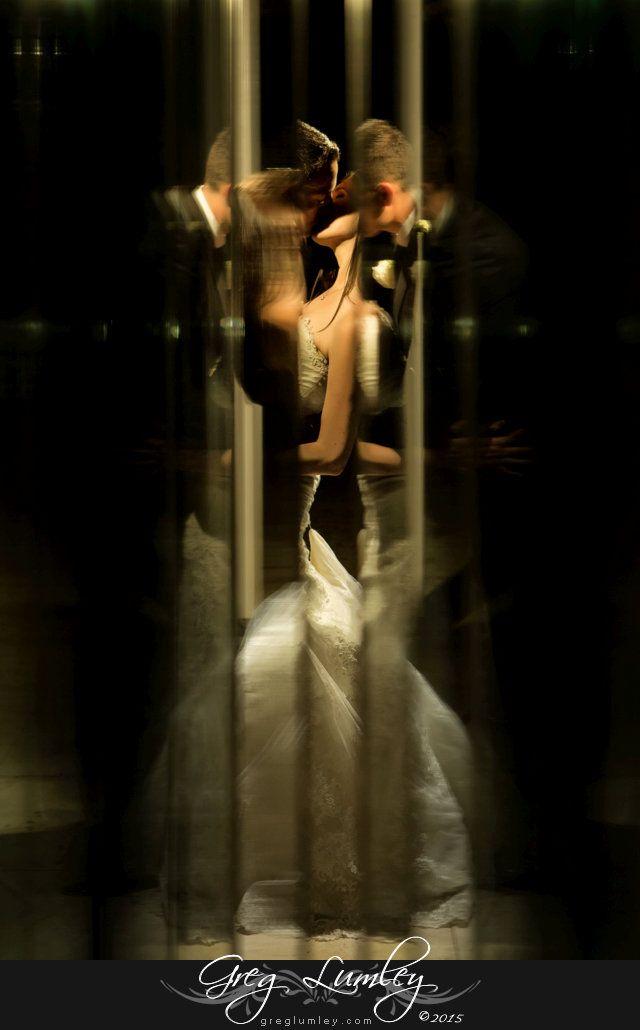 Creative wedding photo using glass reflections at Lourensford Wine Estate.  Wedding photos taken at night.