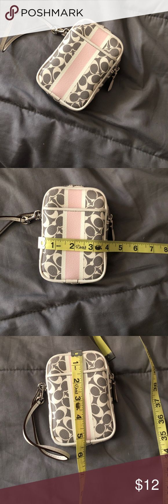 Wallet/ cell phone carrier Pink grey and white wallet/cell phone case. Not sure if this is real, price depicts that Bags Clutches & Wristlets