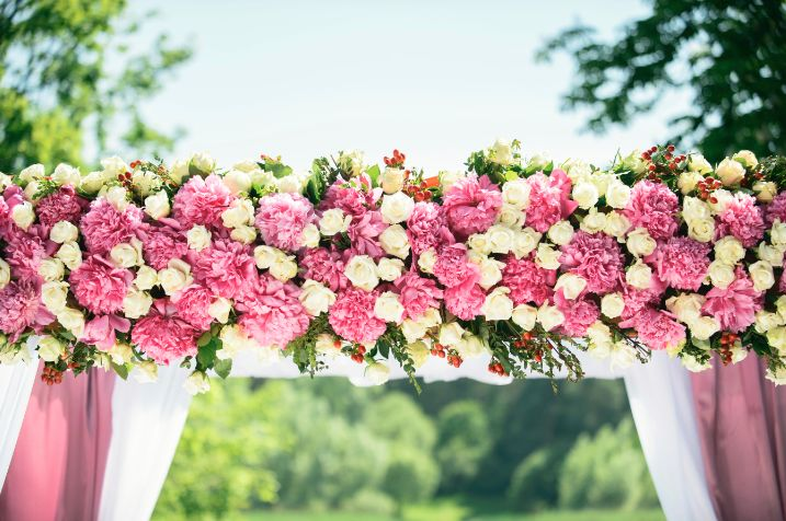 A rose is sweeter on the vine..... Except when beautifully arranged with carnations for a special ceremony!