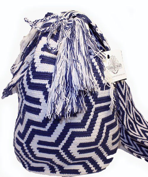 Each of these bags is hand-woven by the tribe's woman artisans using age old traditions. . Each design incorporated into every Wayuu bag is unique to the weaver, telling a story through the bag's colo