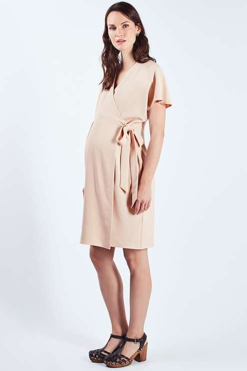 Mix up your pregnancy look with soft tailoring in this simple wrap dress. A fuss-free style, this simple midi features a cinched-waist with self-tie detail for a flattering fit and a v-neckline. #Topshop