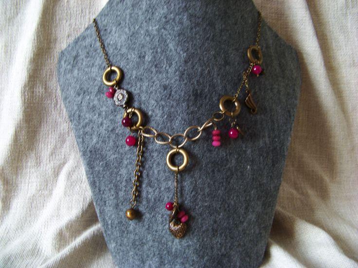 Steampunk cherry. Pink garnet and glass beads.