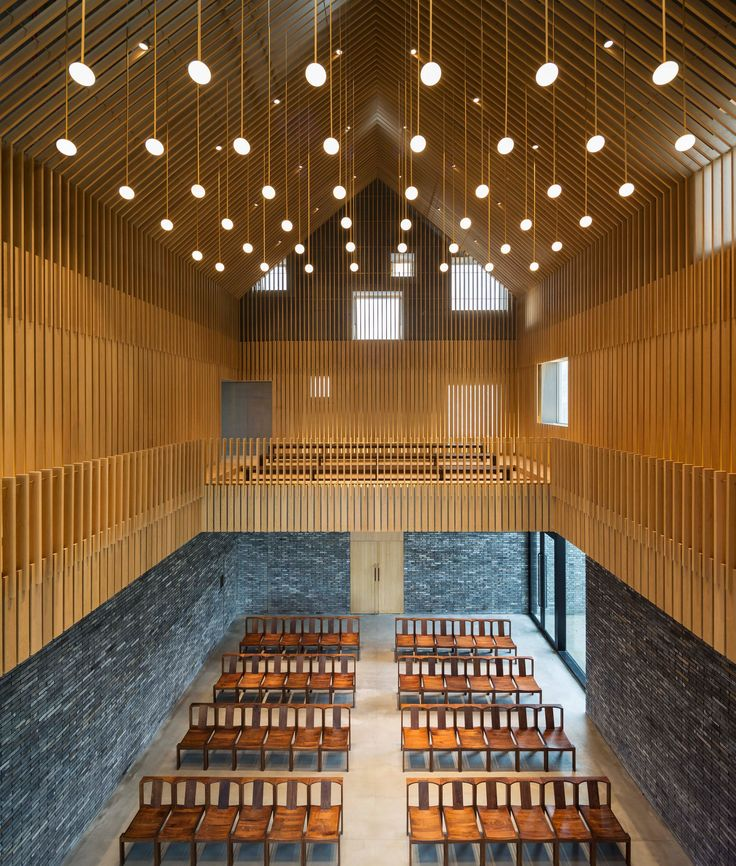 """Perforated metal surfaces form a white """"veil"""" around the main hall of this chapel designed by Neri&Hu for a hotel complex near the Chinese city of Suzhou"""