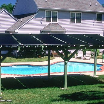 Pergola solar pool heating system. Free heat for a warmer pool and a place to get out of the blazing sun. - Yelp
