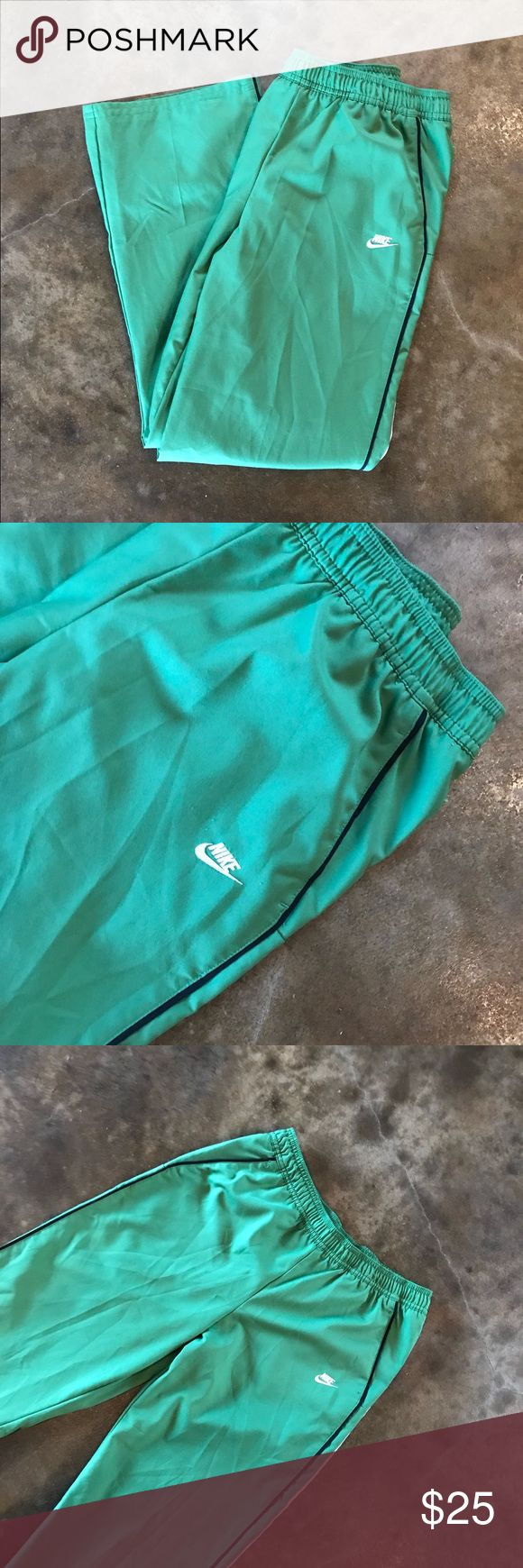 Vintage 90's Nike Original Green Track Pants S Maybe worn once! A vintage staple! Has slits (factory made) at the bottoms to fit over shoes. 20% off all bundles & I ship within 24 hours!  Nike Pants Track Pants & Joggers