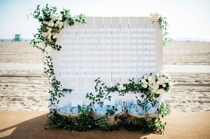 Beach wedding escort card display