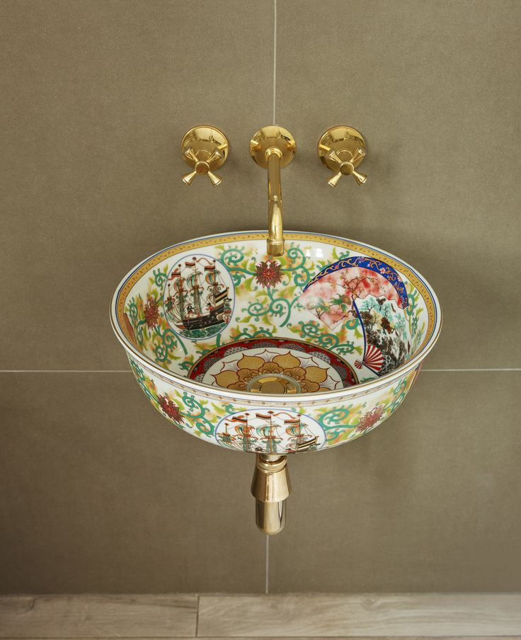 Unique floating basin with rich patterns and gold-effect fittings.