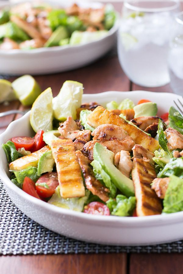 Chicken, Haloumi and Avocado Salad ~ A loaded salad filled with crunchy lettuce, creamy avocado slices, juicy grape tomatoes, melt-in-your-mouth haloumi cheese, and tender, sweet chili & lime marinated chicken, dressed in a lime salad dressing.