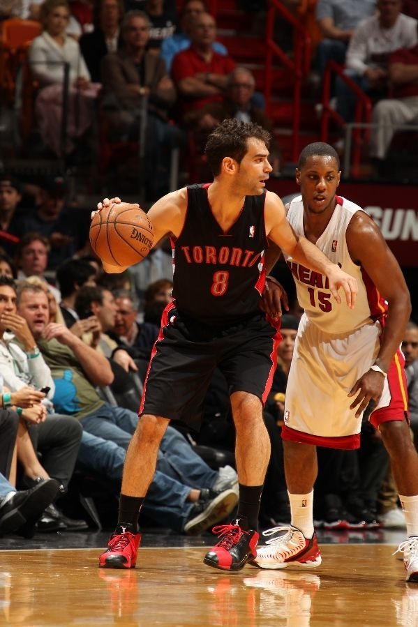 MIAMI, FL - JANUARY 23: Jose Calderon #8 of the Toronto Raptors controls the ball against Mario Chalmers #15 of the Miami Heat on January 23, 2013 at American Airlines Arena in Miami, Florida. NOTE TO USER: User expressly acknowledges and agrees that, by downloading and/or using this photograph, user is consenting to the terms and conditions of the Getty Images License Agreement. Mandatory copyright notice: Copyright NBAE 2013 (Photo by Issac Baldizon/NBAE via Getty Images)