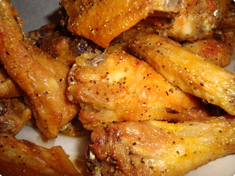 WINGSTOP COPY CAT LEMON GARLIC PEPPER WINGS  2 lbs. chicken wings 1/2 c. lemon juice 1 whole garlic clove (4 slices chopped) 1 tbsp. pepper 2 tbsp. salt 1/4 c. vegetable oil  Place wings in bowl; pour on lemon juice, garlic and pepper. Sprinkle salt and pout oil; stir. Marinate for 2 hours at room temperature, stirring occasionally to keep coated. Wings may be barbecued or placed in saucepan and baked 20 to 30 minutes, basting occasionally.