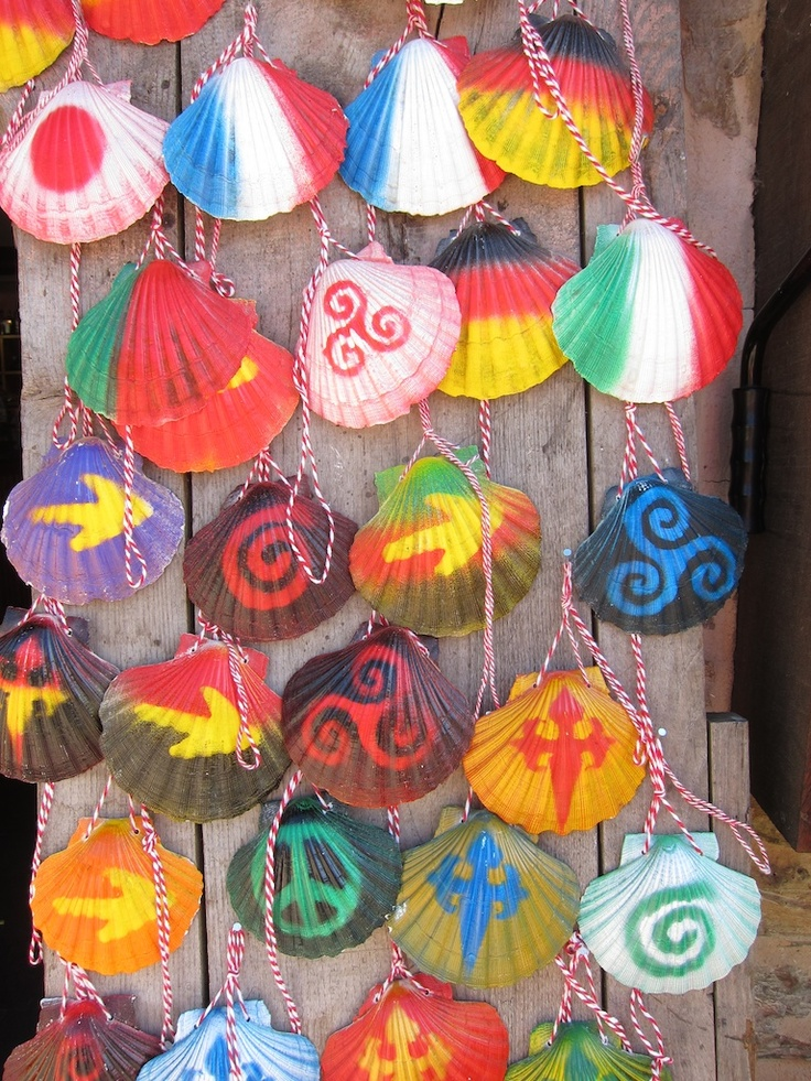 Painted scallop shells on sale for passing pilgrims. The scallop traditionally came from Finisterre and was worn by pilgrims as a badge that they had arrived there.