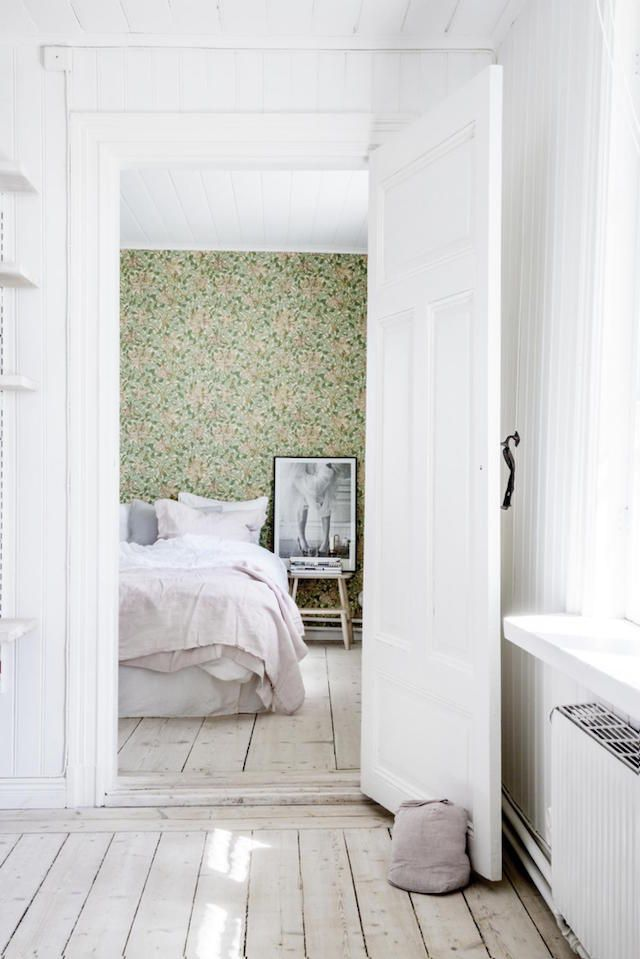 William Morris wallpaper in the bedroom of a dreamy, rural Swedish summer cottage of Erica Franzén.