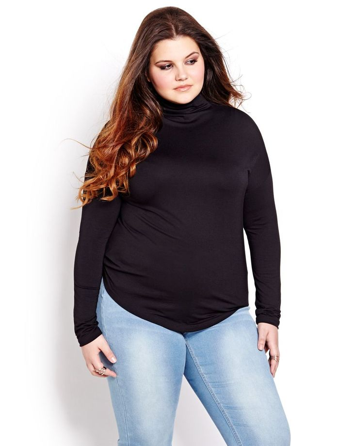 Snug fit, trendy long dolman sleeve top, with mock neckline. Plus size, 26 inch length. Wear it with your favorite pair of ripped jean or denim skort! ONLY AVAILABLE ONLINE AND IN SELECT STORES.