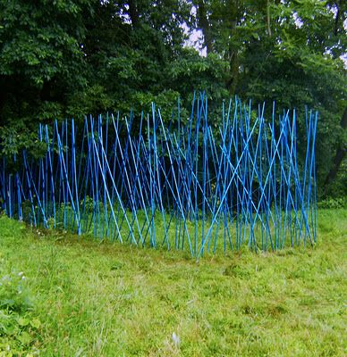 Stacy Levy. i really love environmental sculpture, the unexpectedness, and in this case the colour blue sings against the green