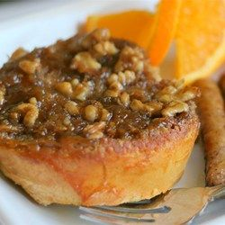 A simple baked French toast that won't have you slaving over a hot stove. An orange batter and caramel pecan coating make this baked French toast so delicious, you won't need any syrup.