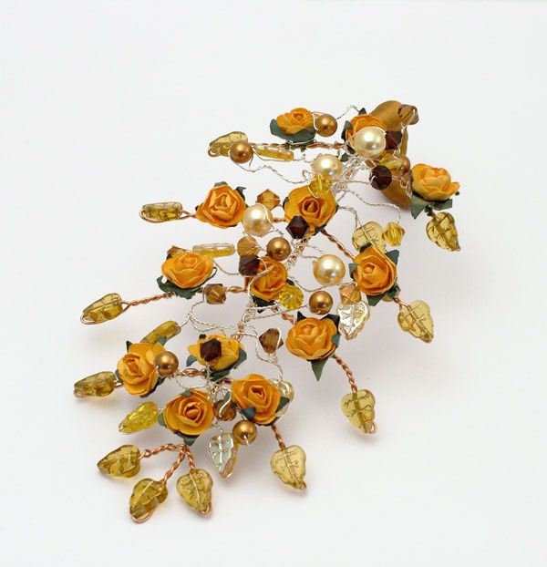 Medieval bridesmaids bouquet made with glass leaves, orange roses, glass pearls and crystals. The mix of yellows, orange, greens and browns gave the bouquet a lovely warm woodland feel. I also made a mini cake topper in this design!