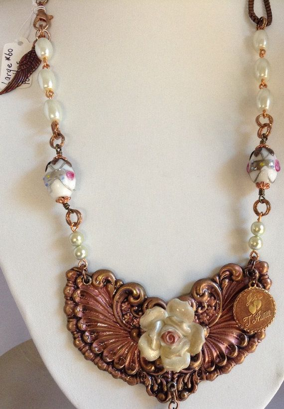 Check out this item in my Etsy shop https://www.etsy.com/au/listing/250129671/large-wings-statement-necklace