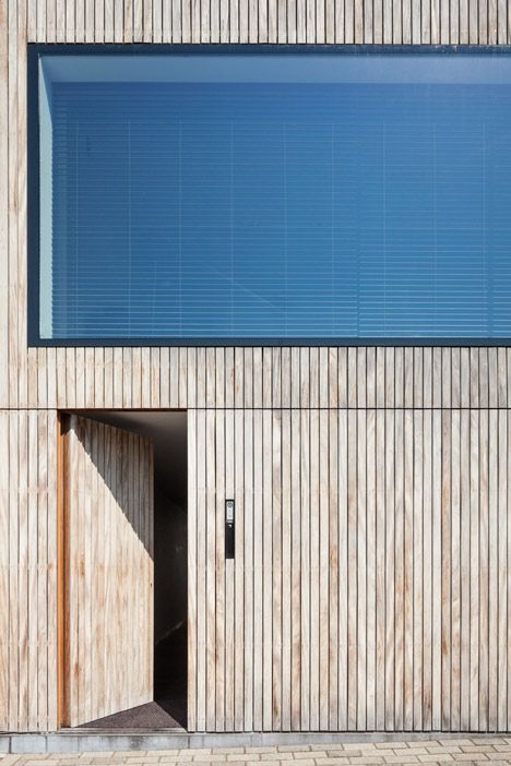 House CM is a contemporary terraced house wrapped in timber-cladding