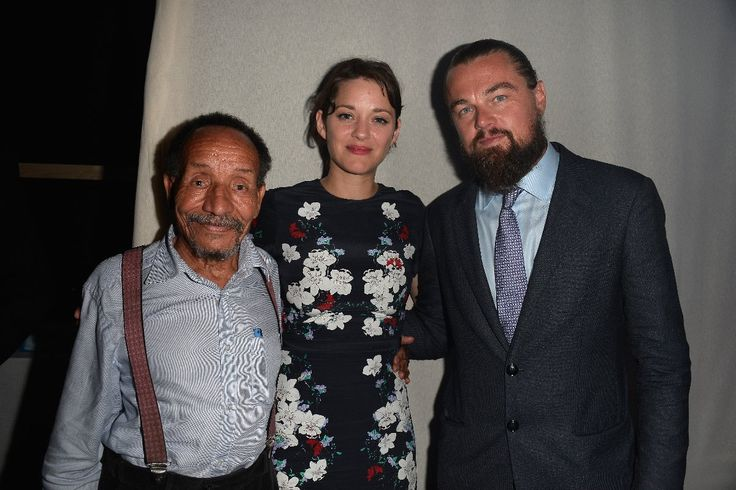 SAINT-TROPEZ, FRANCE - JULY 22: (L-R) Pierre Rabhi, Marion Cotillard and Leonardo DiCaprio attend a Dinner and Auction during The Leonardo DiCaprio Foundation 2nd Annual Saint-Tropez Gala at Domaine Bertaud Belieu on July 22, 2015 in Saint-Tropez, France.  (Photo by Handout/Getty Images)