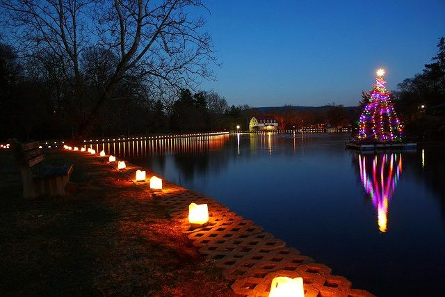The floating Christmas tree, hundreds of luminaries and Santa rowing across  the lake to greet the children in the gazebo add to the holiday b… - The Floating Christmas Tree, Hundreds Of Luminaries And Santa Rowing