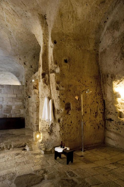 Albergo della Civita.  Matera, Italy. UNESCO world heritage listed. The hotel is spread over a number of Sassi or caves, simply furnished. Lovingly restored.Modern black bathtub, shower.