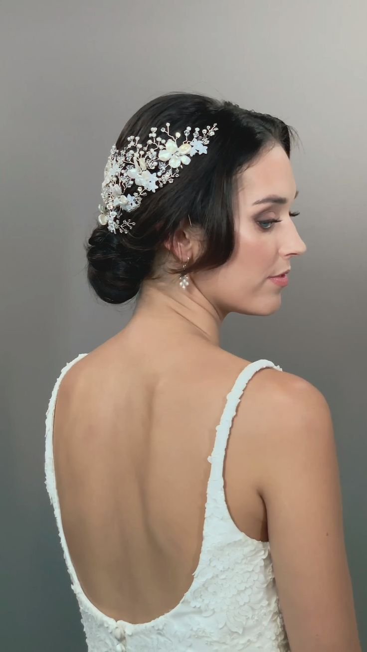Elegant Whimsical Classic Chic Glamorous Bride Hairpins Pearl blooms with Swarovski crystal accents surrounded by freshwater pearl clusters on silver vines. Cluster together above a veil or wear to either side.