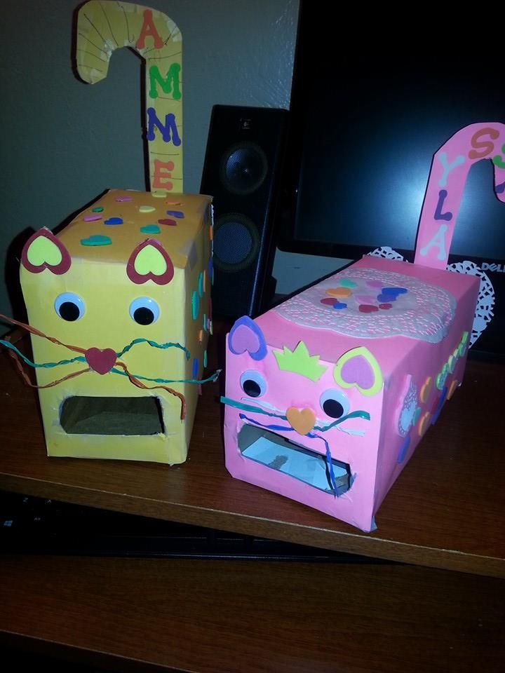 Cat Valentine Card Box:  Using an empty popcorn and saltine boxes we created fun cat card holders for Valentine's Day.  We covered the boxes with construction paper and stickers.