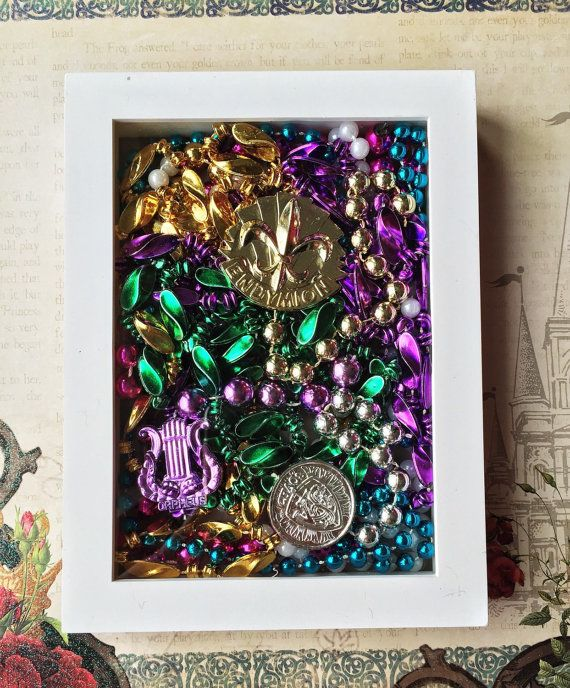 Shadow box filled with beads caught this year at Mardi Gras parades Endymion,Orpheus and Knights is Chaos!! 5×7 in size