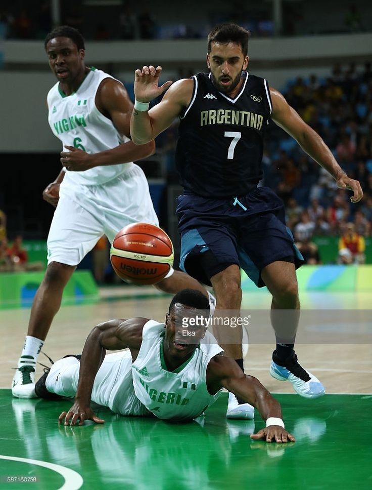 Chamberlain Oguchi of Nigeria falls to the court against Facundo Campazzo of Argentina during a Men's preliminary round basketball game between Nigeria and Argentina on Day 2 of the Rio 2016 Olympic Games at Carioca Arena 1 on August 7, 2016 in Rio de Janeiro, Brazil.